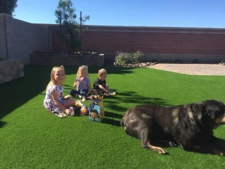 Kids sitting on artificial turf