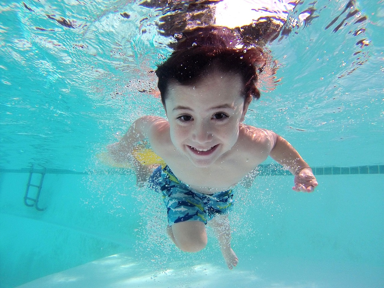 See How Artificial Grass Can Help Keep Your Pool Clean
