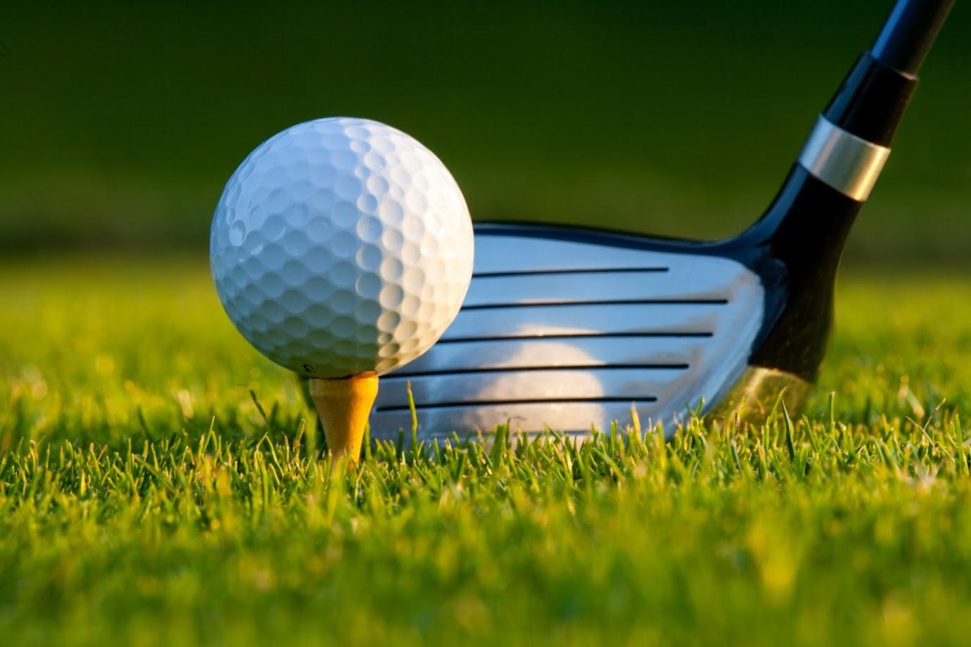 5 Practical Reasons to Add a Backyard Putting Green - image golfing on https://www.sunburstlandscaping.com